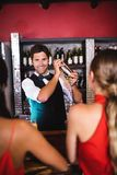 Bartender shaking cocktail in cocktail shaker at bar counter. In nightclub royalty free stock photos