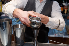 Bartender is squeezing citrus juice royalty free stock photo