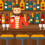 Bartender standing at the bar counter. Royalty Free Stock Image