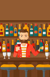 Bartender standing at the bar counter. Royalty Free Stock Photos