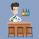 Bartender standing at the bar counter. Stock Image