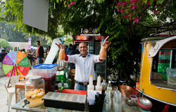 Bartender standing behind the street bar Stock Image