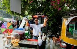 Bartender standing behind the street bar Stock Image