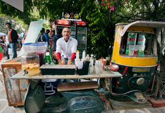 Bartender standing behind the weird retro style counter Royalty Free Stock Photography