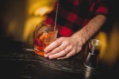 Bartender is stirring cocktails on bar counter Stock Image