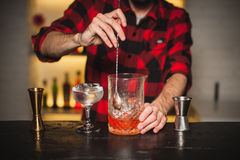 Bartender is stirring cocktails on bar counter Royalty Free Stock Photos
