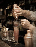 Bartender is straining cocktail Royalty Free Stock Photography