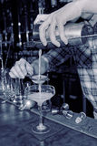 Bartender is straining drink in a glass Royalty Free Stock Image