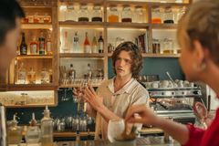 Bartender taking drink orders from customers in a trendy bar Stock Photography