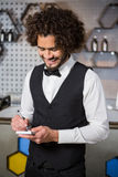 Bartender taking an order. In a bar Stock Image