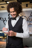 Bartender taking an order. In a bar Royalty Free Stock Photo