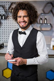 Bartender taking an order. Portrait of bartender taking an order in a bar Royalty Free Stock Photo