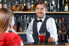 Bartender talking to visitor Stock Photography