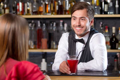 Bartender talking to visitor Royalty Free Stock Images