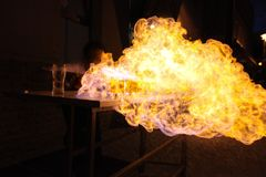 Bartender throwing flame on alcoholic drinks royalty free stock photography