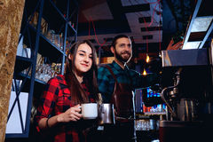 Bartender and waiter are working behind counter in the bar royalty free stock images