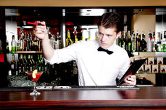Bartender waiting an order. Royalty Free Stock Image