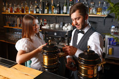Bartender and a waitress in the bar Royalty Free Stock Image