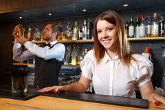 Bartender and a waitress during work Stock Image