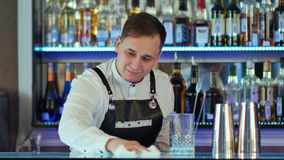 Bartender wiping down bar counter. Close up. Professional shot in 4K resolution. 086. You can use it e.g. in your commercial video, business, presentation Stock Photos