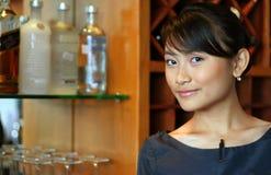 Bartender at work. Sweet smiling bartender at work Stock Images
