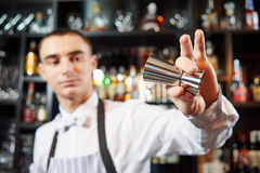 Bartender work at bar. Young barman worker at bartender desk in restaurant bar preparing coctail Stock Photo