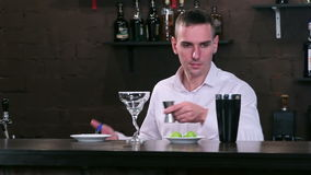 Bartender at work behind the bar stock video