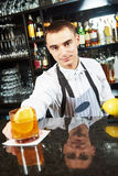 Bartender worker at bar with coctail stock images