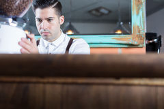 Bartender working in bar Royalty Free Stock Photography