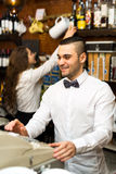 Bartender working at checkout counter Royalty Free Stock Photography