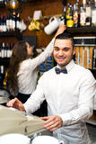 Bartender working at checkout counter Stock Photo
