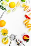 Bartender workplace for make fruit cocktail with alcohol. Shaker, strainer and other bar tools near citrus fruits and. Glass with cocktail on white background royalty free stock images