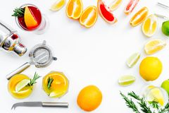 Bartender workplace for make fruit cocktail with alcohol. Shaker, strainer and other bar tools near citrus fruits and. Glass with cocktail on white background stock photography