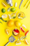 Bartender workplace for make fruit cocktail with alcohol. Shaker, strainer and other bar tools near citrus fruits and. Glass with cocktail on yellow background stock images