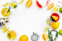 Bartender workplace for make fruit cocktail with alcohol. Shaker, strainer and other bar tools near citrus fruits and. Glass with cocktail on white background royalty free stock photography