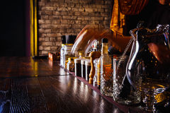 Bartender works with tools on bar Royalty Free Stock Photography