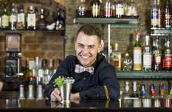 Bartender. Young man working as a bartender in a nightclub bar Royalty Free Stock Images