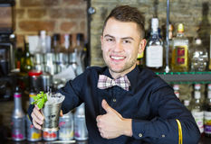 Bartender. Young man working as a bartender in a nightclub bar Royalty Free Stock Photography
