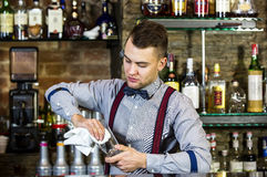 Bartender. Young man working as a bartender in a nightclub bar Stock Photo