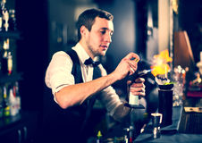 Bartender. Young man working as a bartender in a nightclub bar Stock Photos