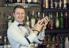 Bartender. Young man working as a bartender in a nightclub bar Royalty Free Stock Photos