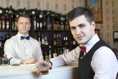 Bartender. Young men working as a bartender in a nightclub bar Royalty Free Stock Photography