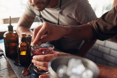 Bartenders experimenting with creating cocktail mixing ideas Royalty Free Stock Image