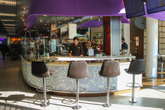 Bartenders serve customers in the cafe at the airport Amsterda