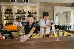 Bartenders working at counter in restaurant Stock Images