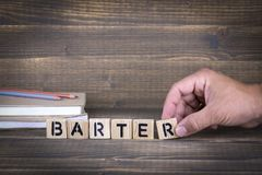 Barter concept. Wooden letters on the office desk. Informative and communication background royalty free stock photography