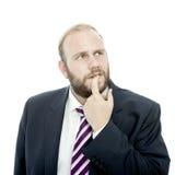 BartGeschäftsmann ist denkend und ungewiß stockbilder