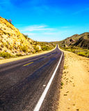 The Bartlett Dam Road as it winds through the semi desert landscape of Tonto National Forest. In Arizona, United States Stock Photos