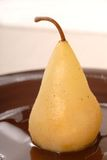 Bartlett pear poached in white wine and vanilla Royalty Free Stock Photos