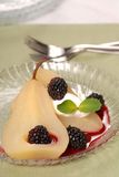 Bartlett pear poached in wine Royalty Free Stock Photo